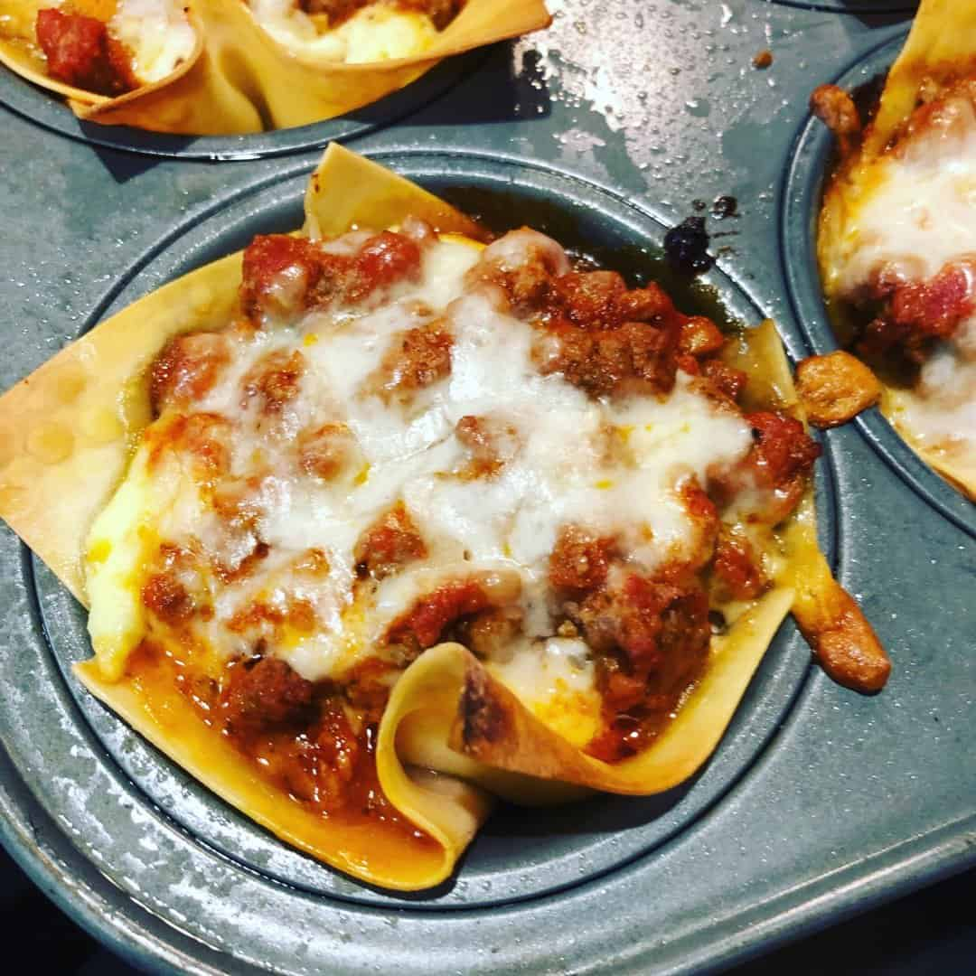 An easy recipe for lasagna cups are a portable meal option the whole family will love! They're a tractor friendly meal, too!
