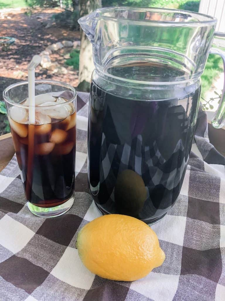 outside photo of lemon, glass and pitcher of iced tea made in the instant pot