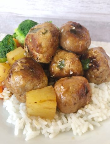 sweet and sour pork meatballs on a bed of rice