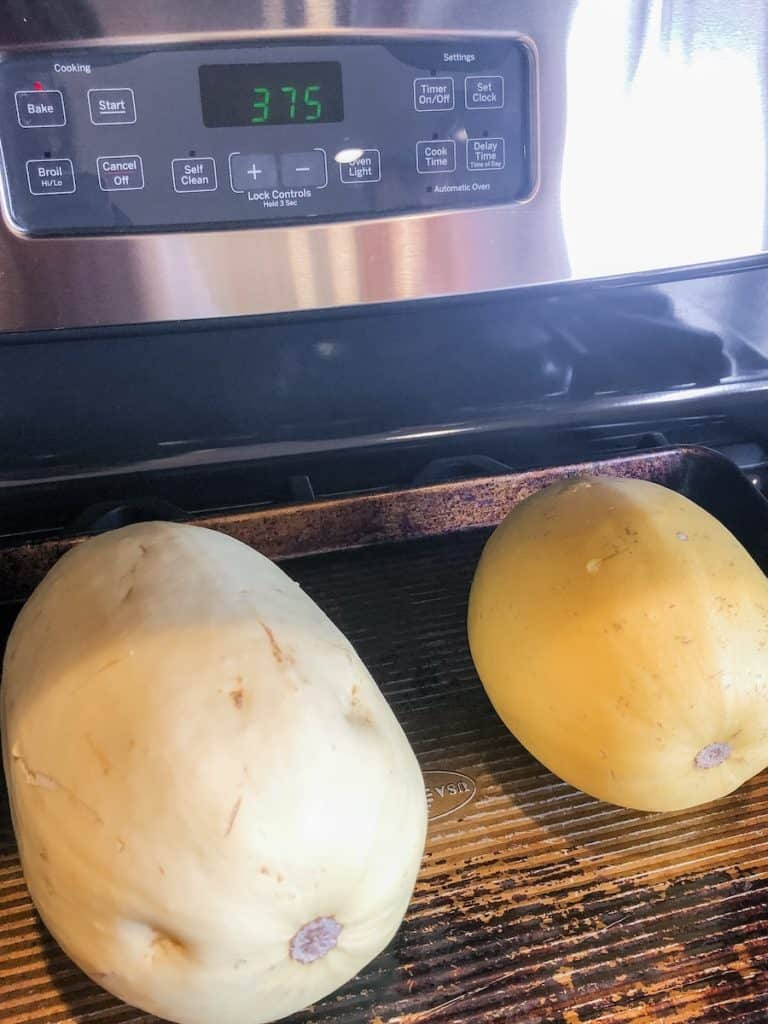 two whole spaghetti squash on stovetop