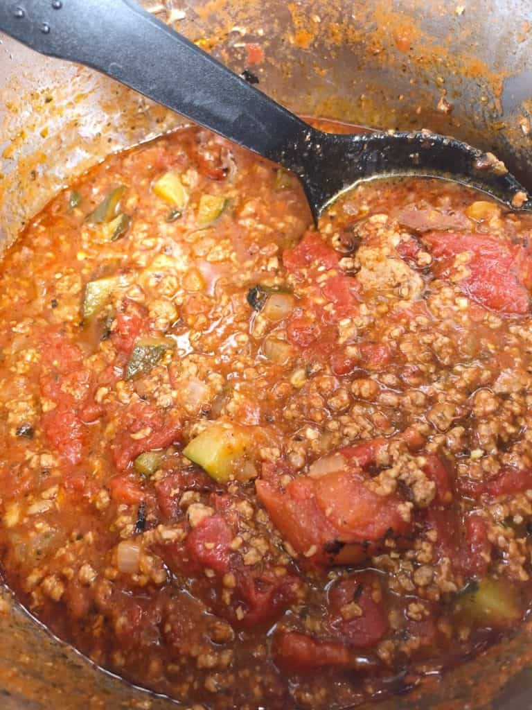 healthy meat sauce with zucchini, tomatoes, onions and mushrooms