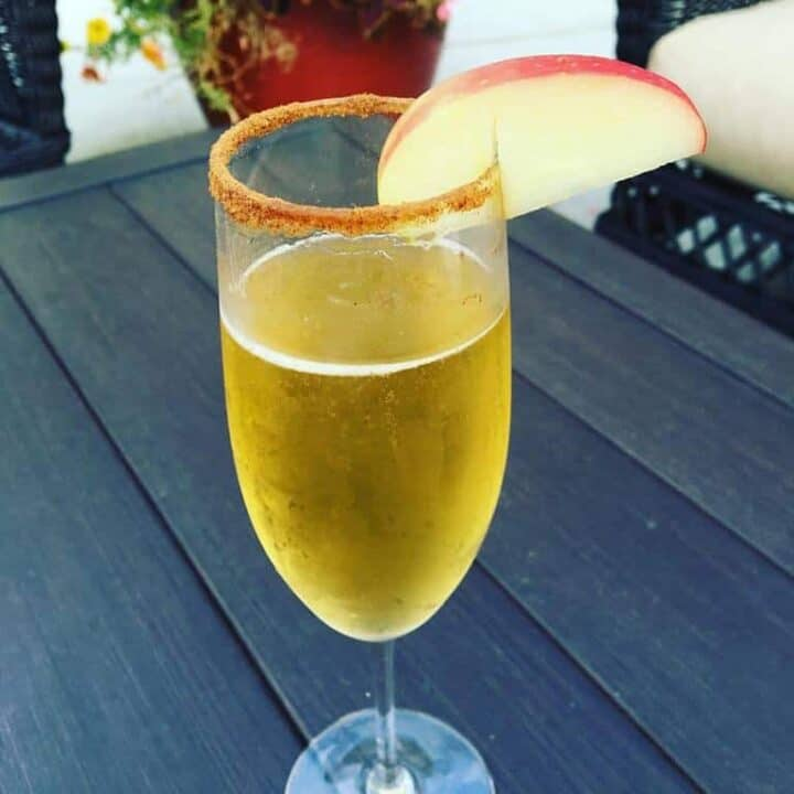 champagne flute of apple cider mimosa