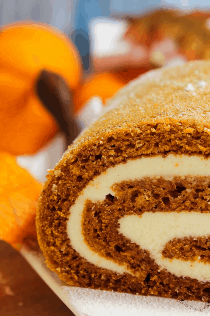 homemade pumpkin roll cake with cream cheese frosting