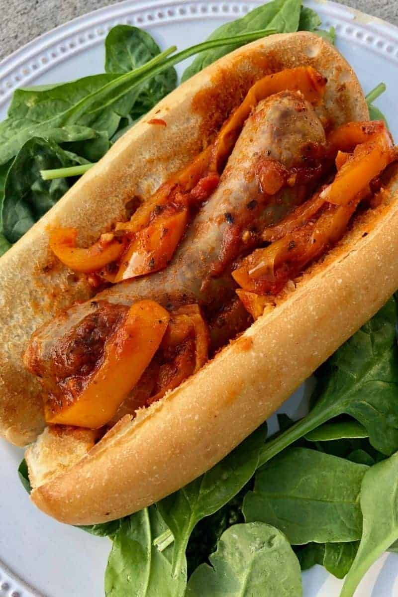 crockpot italian sausage and peppers on a bun with tomato sauce